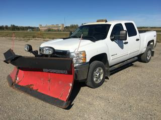 """2011 Chev Silverado 2500 HD Crew Cab 4x4 c/w Vortec 6.0L V8 Gas, Auto, A/C, Heated Seats, The Boss Snow Plow Controller In Cab, 9'2"""" Plow S/N BC009694, Spray On Box Liner, Tow Hitch Receiver, Amber Beacon Light, Roll Up Box Cover, Showing 242,776 Kms, VIN 1GC1KXCG0BF170228."""