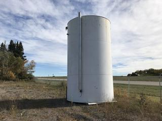 """Selling Off Site - 12' x 20' 1993 NWP """"L"""" Skidded 400 BBL Production Tank. 1/4"""" Floor, 3/8"""" Shell and deck, gauge board, ladder with hoop, 24"""" x 36"""" square manway, insulated down comer, S/N 400754, Located Near Cottonwood Rd. & 42nd Ave. in Innisfail, Buyer Responsible for Load Out."""