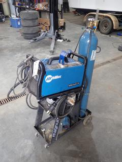 Miller Millermatic 211 Single Phase MIG Welder C/w Miller Stinger, Assorted Welding Wire, Compressed Gas Tank And 27in X 12in X 27in Magnum Welding Cart