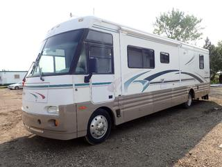 1999 Winnebago Freightliner FRHT IKL36L 36ft Motorhome C/w 5.9L Cummins Turbo, Diesel, A/T, 6-Speed Allison, Sony SSM-721AMR Driving Monitor, JVC Stereo, Cobrn 18WX STII Sand Tracker HWH Hyd Leveling System, Air Brakes, (1) Bed, (1) Shower, (2) Sinks, (1) Toilet, Norcold Electric/Propane Fridge, Propane Magic Chef Stove, Built In Diesel Generator Showing 347hrs, Sansui Flat Screen TV, Built In Vacuum System, Engine Air Compressor, Kitchen Slide Out, 50A Power Supply Plug In, Automatic Winterizing System And (2) Canopy's. Showing 103,182 Miles. VIN 4VZHXFBC4XCB80776 *Note: Check Valve Getting Replaced, Item Cannot Be Removed Until Monday August 23rd, For More Information Contact Connor @780-218-4493*