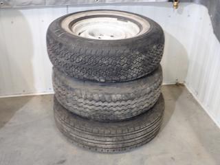 Carlisle Radial Trail ST 235/80 R16 Tire w/ 6-Stud Steel Rim C/w Michelin Radial XP 235/75 R15 Tire w/ 6-Stud Steel Rim And Goodyear Arrival P235/75 R15 Tire w/ 6-Stud Steel Rim