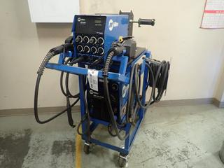 Miller XMT 304 CC-CV 240/460V 1/3-Phase DC Inverter Arc Welder C/w Miller 60 Series D-64 24V Wire Feeder SN KG149871, Cable And Cart. SN LC045082