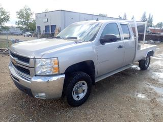 2007 GMC Sierra 2500HD Extended Cab 4X4 Flat Deck Truck C/w 6.0L Vortec, A/T, 8ft X 77in Aluminum Deck, Rails, Rack, Storage Box, Checker Plate Running Boards And 245/75 R16 Tires. Showing 334,916kms. VIN 1GCHK29K57E575513. *Note: Rust On Front Passenger Wheel Well, Check Engine Light On, Service Air Bags Code, Damage To Driver Rear View Mirror And Drivers Inside Door Handle Missing*