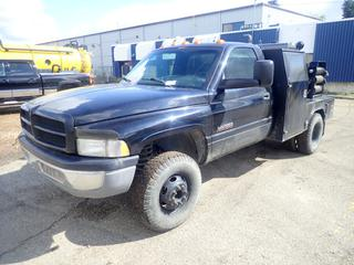 2001 Dodge Ram 3500 4X4 Flat Deck Truck C/w Cummins 24 Valve Turbo Diesel, Manual, 90in X 70in Deck, (5) Storage Boxes, Irwin Record No.6 Vise, Aluminum Hose Reel w/ Acetylene Hose, International Tool Box And Lincoln Electric Classic 300D Diesel Welder w/ Perkins Engine, Stand And Assorted Welding Cable, Showing 3889hrs. Showing 200,205kms. VIN 3B6MF36641M537907 *Note: Hole In Drivers Seat*
