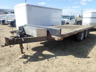 2012 18ft Double A Trailers T/A Flat Deck Trailer C/w Pintle Hitch, 12,000lb Ram Trailer Jack, 51in X 17in X 12in Storage Box And 6350kg GVWR. VIN 2DAHC5275DT014184