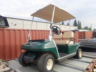 Club Car Electric Golf Cart C/w Club Car Model 17930 Industrial Battery Charger. SN A9742-615003 *Note: No Batteries, Tire Off Bead And Back Tire Slashed, Running Condition Unknown*.