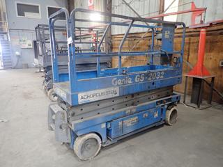 Genie GS-2032 Electric Scissor Lift, 20' Maximum Platform Height, 550 LB Capacity, No Keys, Showing 554 Hours, Running Condition Unknown, No Serial Number.