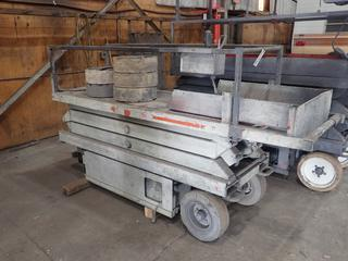 Skylift SJIII-3220 24v Scissor Lift, 20' Maximum Platform Height, 800 LB Capacity, Tire & Axle Removed, Unknown Running Condition, Hours Unknown, S/N 613199.