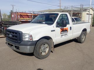 2007 Ford F-250 XL Super Duty Regular Cab Pickup C/w 5.4L V8 Triton, A/T, Long Box, Galvanized Steel Truck Rack, Plywood Box Liner And 265/70 R17 Tires. Showing 128,231kms. VIN 1FTNF20517EA37504 *Note: Vehicle Comes With Maintenance Records. Dent In Passenger Rear Side Panel*