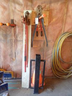 (1) Pipe Bender, (1) Bolt Cutter, (1) Wire Cutter And (1) Post Pounder