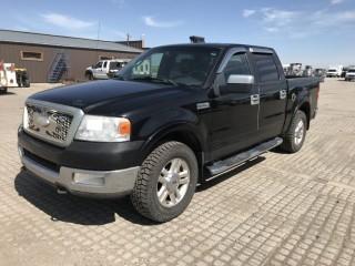 2006 Ford F150 Lariat P/U c/w 5.4L, Auto. Showing 300,592 Kms. Rebuilt Status. S/N 1FTPW14546KB91380