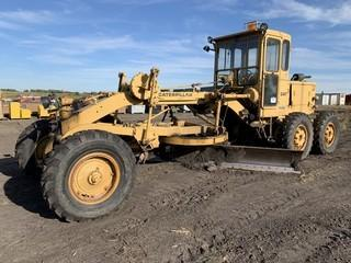 CAT 12 Grader C/w 12ft MB, 4ft Hyd MB Extension, 13.00-24ft Rubber, Wheel Weights, Front Scarifier, CAB. Unit 208. *Note: Oil Leak, SN OBL*