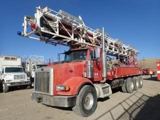 Unit 815: 2004 IR TH75E Mobile Drill Truck Mounted On 2005 Peterbilt Model 378 Single Steer Tri-Drive Truck. CVIP Expires 11/2019. Showing 11,695kms. VIN 1NPFXBEX35D850317 **LOCATED IN CARBON**