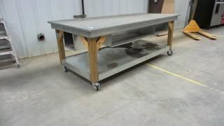 4 FT x 8 FT Work Table on Wheels, (some wheels require repair)