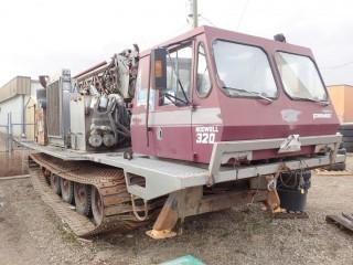 UNIT 387 1980 Nodwell 320 Drill c/w 387D Artic shot-hole drill # 901673. Showing 9030Hrs.
