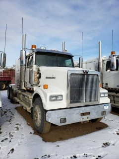 2016 Western Star 4900SE, S/N 5KVVAED15GPGWS2036, 282641 KMS, 7408 Hours,DD15 Engine, 18 Speed, Double Diff Lock, 46in Sleeper, Wheel Base 236, Tires 11R24.5 Fronts at 75 Percent, Front Axles 13300,  Rears at 75 percent Rear Axles 46000, Air Ride Suspension, c/w TK Tripac Evolution, Omnitracs GPS, Posi Air, Tire Chains and Eberspauches Heater, *Glass Damaged*