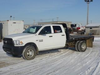 "Unit 121: 2014 Dodge Ram 3500 H/D 4X4 Dually Crew Cab Flat Deck C/w 6.4L, A/T, 9'6"" Deck w/ Ball Hitch. Showing 64,381kms. VIN 3C7WRTCJ6EG317972"
