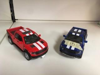 Lot of (2) Kinsmart Ford F-150 Raptor Supercrew 1:46 Scale Trucks.