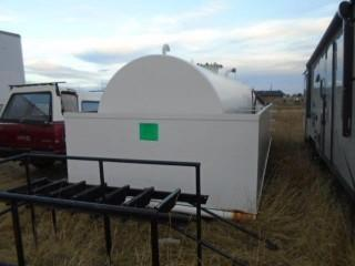 SKID MOUNTED TANK WITH SPILL CONTAINMENT. CAPACITY OF 5000 IMPERIAL GALLONS