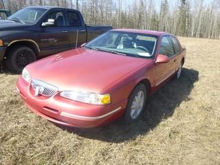 1997 Mercury Cougar XR7 Gold Edition C/w 4.6L V8, A/T. Showing 197,124Kms. VIN 1MELM62W8VH606787. *Note: Paint Chips, Dents And Rust On Vehicle, Passenger To Driver Crack*