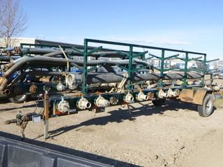 "2013 Manifold Trailer C/w Hose Rack, (14) 4"" Discharge Points, (3) 8"" Inlet Points, (1) Hose w/ Camlock Connection 8"" Diameter, 20 Ft Long And  7.50R16 LT Tires 14 Ply. VIN 1Z9BA2618DN409076"