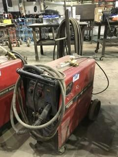Lincoln Power Mig 255C Mig Welder w/ Cart, Hoses, Gun etc.