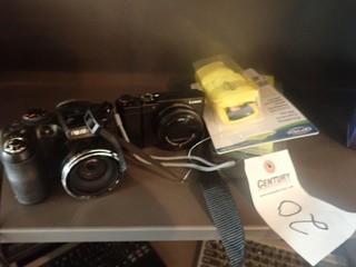 Lot of Lumix Digital Camera, Fuji Digital Camera, Camera Strap and USB Cable.