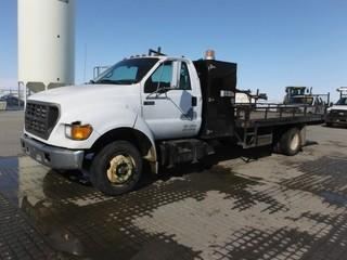 2003 Ford F650 S/A Deck Truck c/w Cummins 5.9L Diesel, Auto, A/C, 14' Deck w/Pipe Rack.  Showing 298,422 Kms.