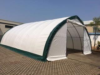 Unused 30'x65'x15' Peak Ceiling Storage Building c/w Commercial Fabric, Waterproof, UV & Fire Resistant, 12'x12' Drive Through Doors At Two Ends. Control # 7023.