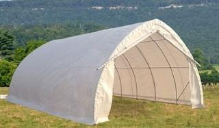 Unused 20'x30'x12' Peak Ceiling Storage Shelter c/w Commercial Fabric, Roll Up Door. Control # 7289.