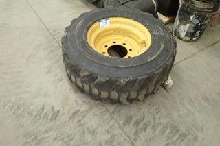 12-16.5 Skid Steer Tire w/ Rim.
