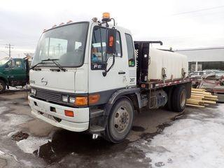2004 Hino FE2620 Single Axle DRW Deck Truck. Diesel Engine, Morse Automatic Transmission, 11R22.5 Tires, 1,325gallon Poly Tank, Coxreels Hose Reel and Hose. Showing 305,738kms. CVIP Expires 03/19. VIN JHBFE2JP241S11288.