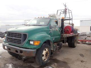 2000 Ford F650 Super Duty XL Single Axle DRW Deck Truck. Cummins Diesel Engine, Automatic Transmission, 10R22.5 Tires, 14' Deck, Turfmaker Corp Hydro Seeder w/ Kohler CommandPro 34 Gas Engine, Coxreels Hose Reel, Hoses, and Connectors. Showing 305,999kms. CVIP Expires 02/19. VIN 3FDNF6583YMA24299.