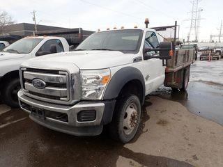 2012 Ford F550 Super Duty XLT Single Axle DRW 4x4 Regular Cab Deck Truck. Powerstroke 6.7L Diesel Engine, Automatic Transmission, 12' Deck w/ Removable Sides and Tarp. Showing 106,645kms. CVIP Expires 02/19. VIN 1FDUF5HT6CEB34719.