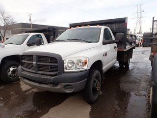 2008 Dodge Ram 3500HD Single Axle DRW 4x4 Regular Cab Dump Truck. Cummins Diesel Engine, Automatic Transmission, 12' Steel Dump Box, Hydraulic Controls, Tarp. Showing 169,556kms. CVIP Expires 03/19. VIN 3D6WH46A08G155112