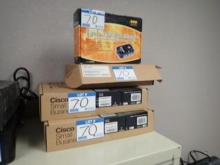 Lot of 2 Cisco SF300-08 Switches, Zyxel VSG1432 VDSL2 Wireless Gateway and Zonet Switch. **LOCATED IN MILK RIVER**