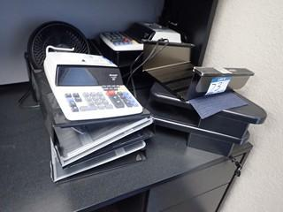 Lot of Paper Trays, Electric Calculators and Monitor Stands. **LOCATED IN MILK RIVER**