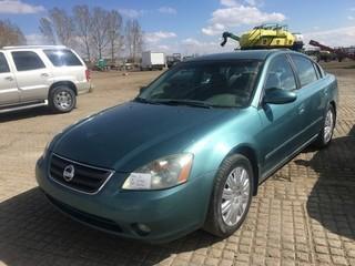 2002 Nissan Altima SE Sedan 3.5L, Auto, A/C. Showing 233,890 Kms. S/N 14NBL11D12C107881