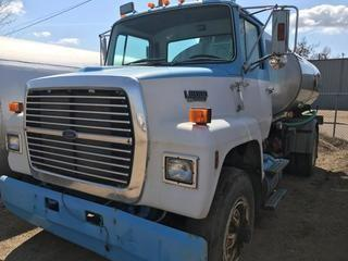 Selling Off-Site 1990 Ford L8000 S/A Truck c/w 1997 Advance 8000 Litre Water Tank and Pump, Eaton Fuller 10 Speed Transmission, Chelsea PTO, 11R 22.5 Tires, 171004 kms, S/N 1FDYR82A0LVA37081.  Location:  339 Aquaduct Dr., Brooks, AB Call Tim For Further Information 403-968-9430.