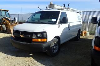 "2014 Chevrolet ""Express 3500"" Cargo Van. Gas Engine. Automatic Transmission. Adrian Steel Cargo Racks. Ranger Fleetline File Box. Ladder Rack. Showing 75,411kms and 2,327hrs. VIN 1GCZGTCG2E1166521."