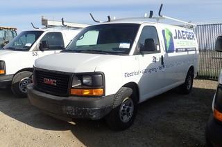 "2010 GMC ""Savana 2500"" Cargo Van. Gas Engine. Automatic Transmission. Ladder Rack. Showing 122,136kms and 2,710hrs. VIN 1GTZGFAA8A1169028."