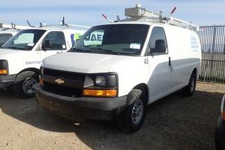 "2010 Chevrolet ""Express 2500"" Cargo Van. Gas Engine. Automatic Transmission. Leather Interior. Weatherguard Cargo Racks and Ladder Rack. Showing 122,841kms and 2,805hrs. VIN 1GCZGFBA8A1102931."