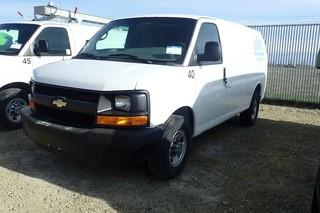 "2011 Chevrolet ""Express 2500"" Cargo Van. Gas Engine. Automatic Transmission. Adrian Steel Cargo Racks. Showing 191,814kms and 4,117hrs. VIN 1GCWGFCG5B1143458."