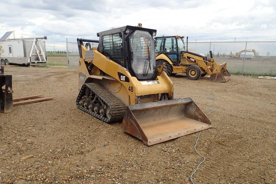 "2012 Caterpillar ""257B Series 3"" Multi Terrain Track Loader. Cat ""C3.4DIT"" Diesel Engine. Rubber Tracks. 66"" Cleanout Bucket. Showing 1,975hrs. VIN CAT0257BEB7H01370."