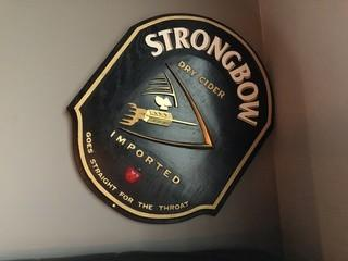 """Strongbow Cider Wood Sign 26"""" x 21""""."""